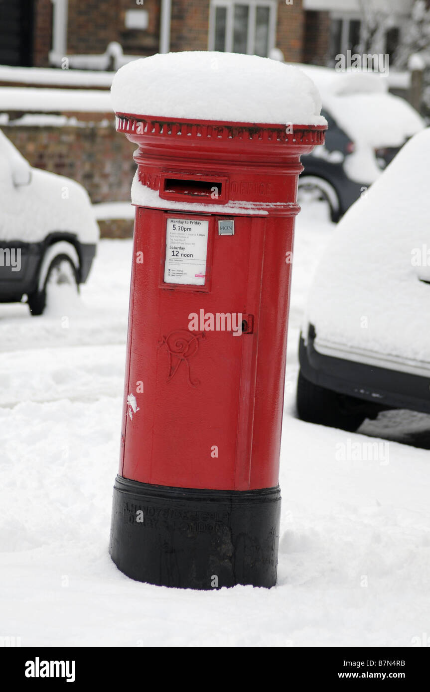 Postbox covered in snow - Stock Image