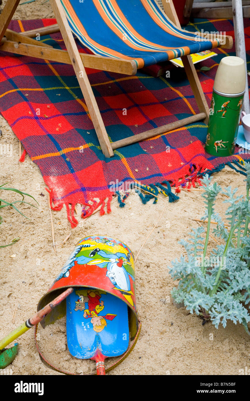 Detail of a bucket and spade on a sandy beach in Great Britain - Stock Image