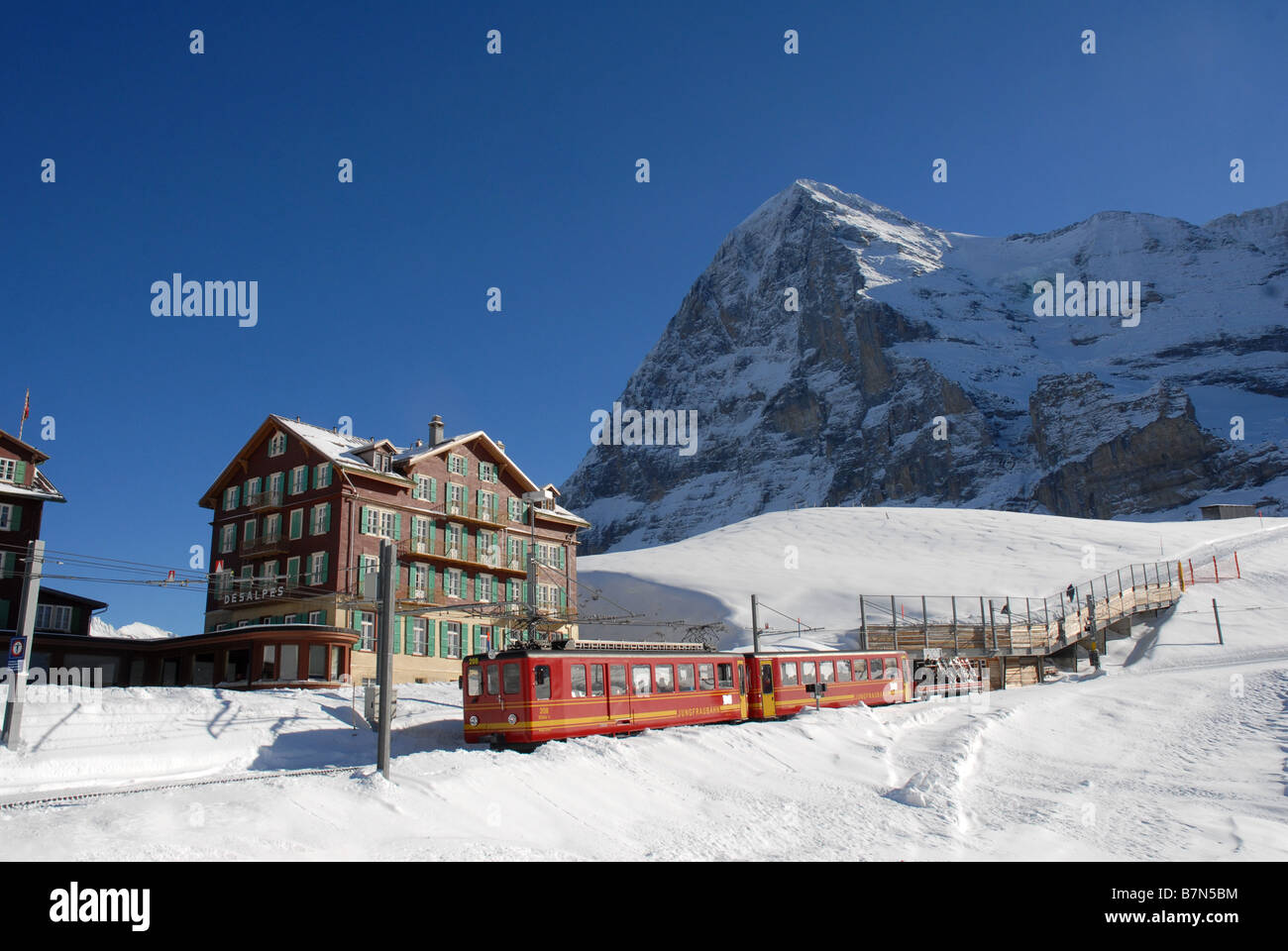 Train leaving kleine scheidegg going to jungfraujoch on the jungfrau mountain in switzerland - Stock Image