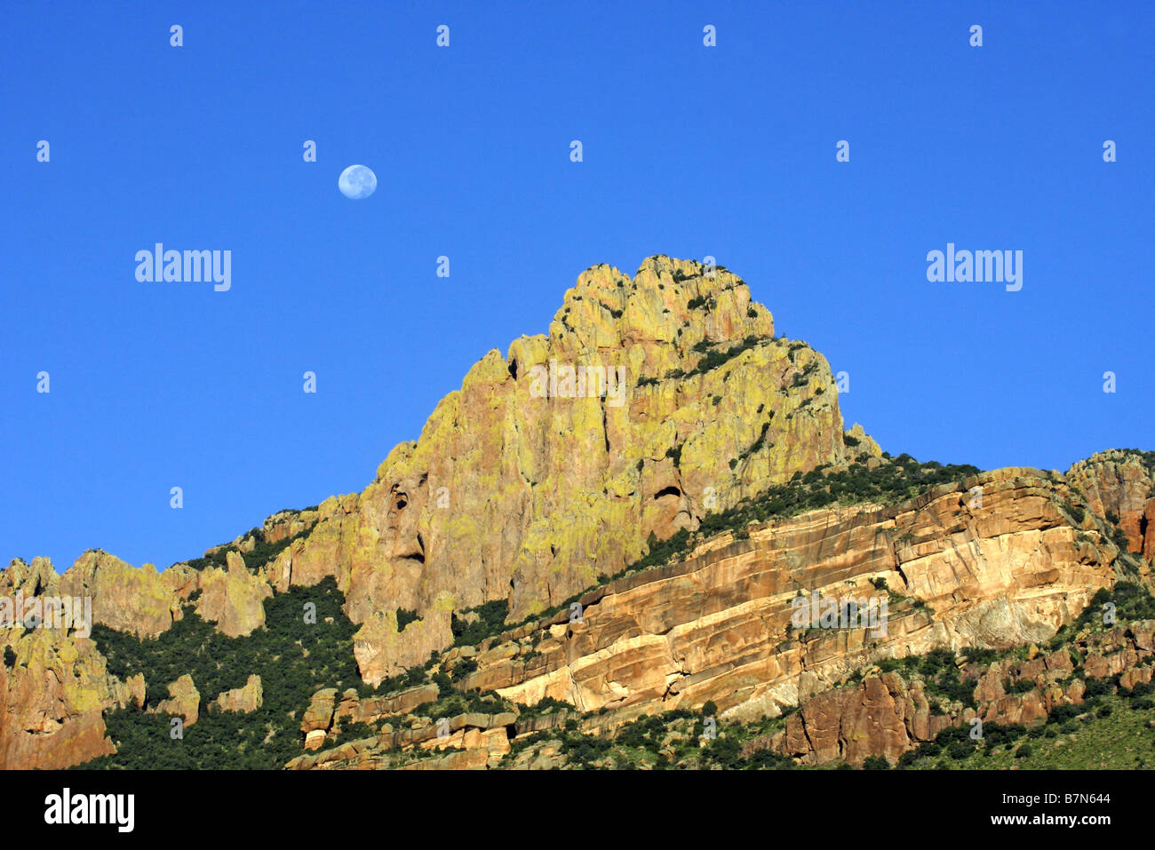 Chiricahua Mountains ARIZONA United States 19 August Moon over lichen covered rocky peak - Stock Image