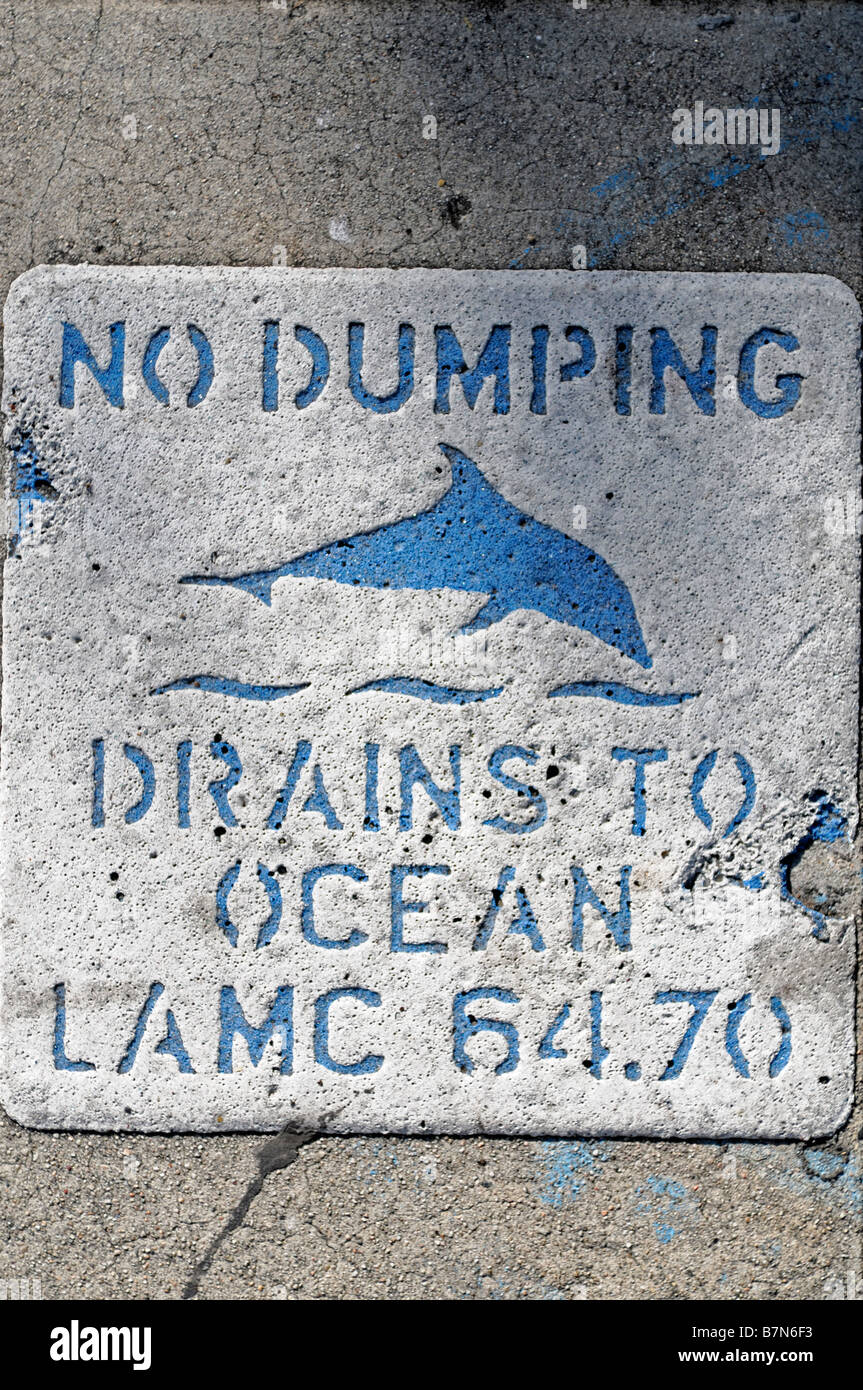 No dumping sign trying to prevent dumping of rubbish in drains help the ocean sea dolphin pacific los angeles california - Stock Image