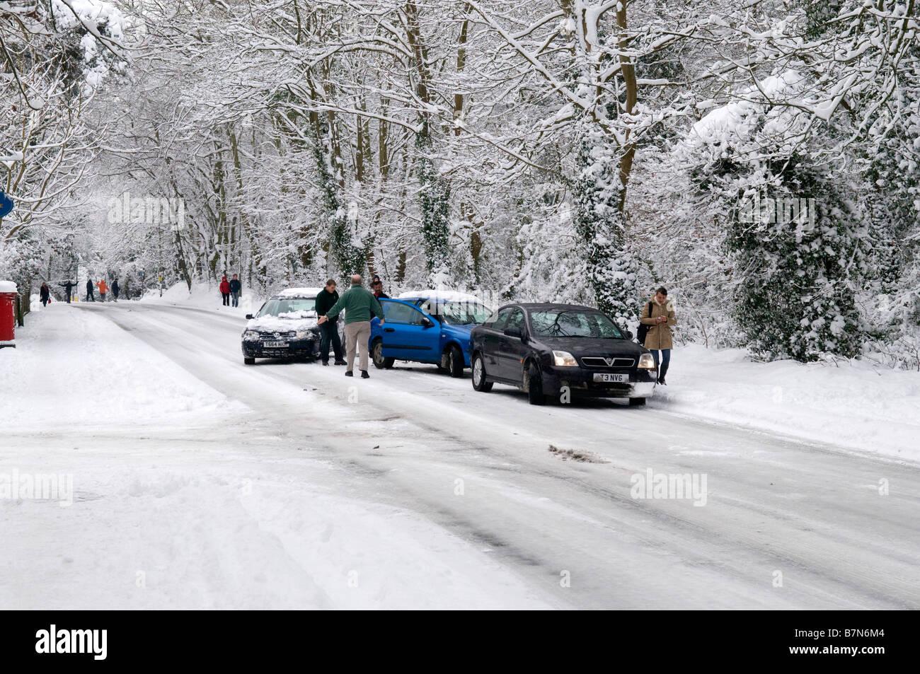 Minor accident due to slippery, icy road, in Weybridge, Surrey - Stock Image