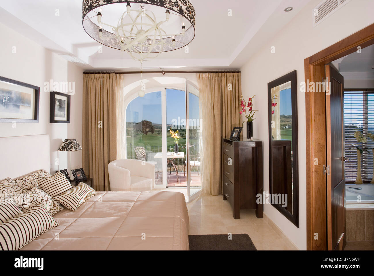 Modern Bedroom In Spanish Holiday Apartment With Patio Doors To Terrace