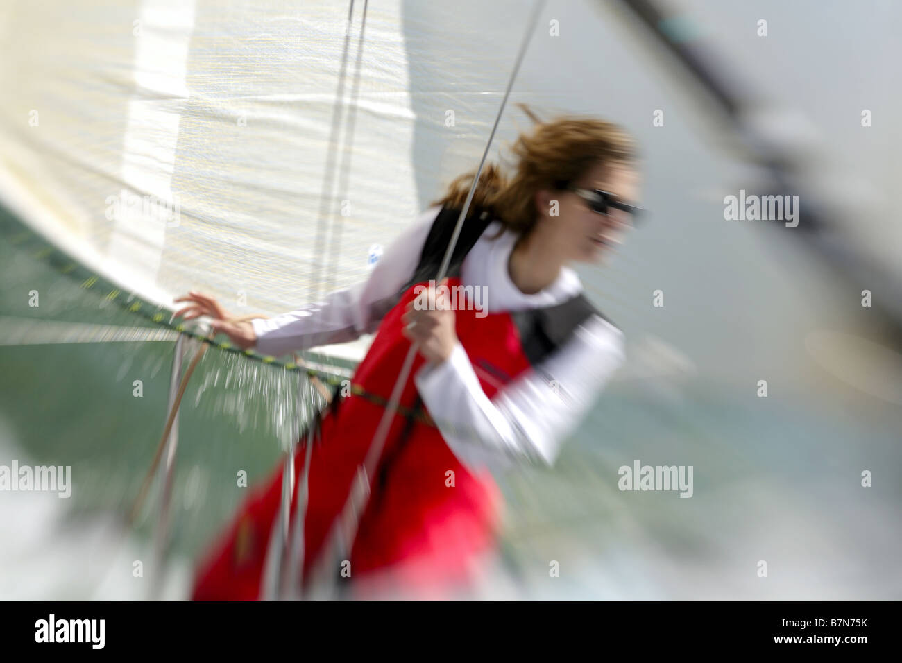 white,european female sailor, sailing a Yacht on the Solent,UK. - Stock Image