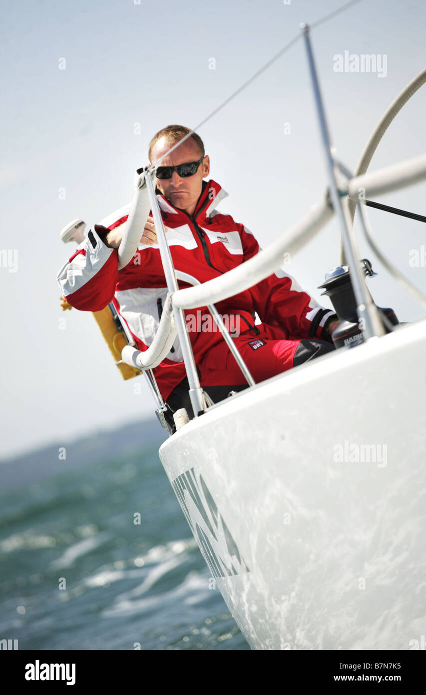 white,european male sailor, sailing a Yacht on the Solent,UK. - Stock Image