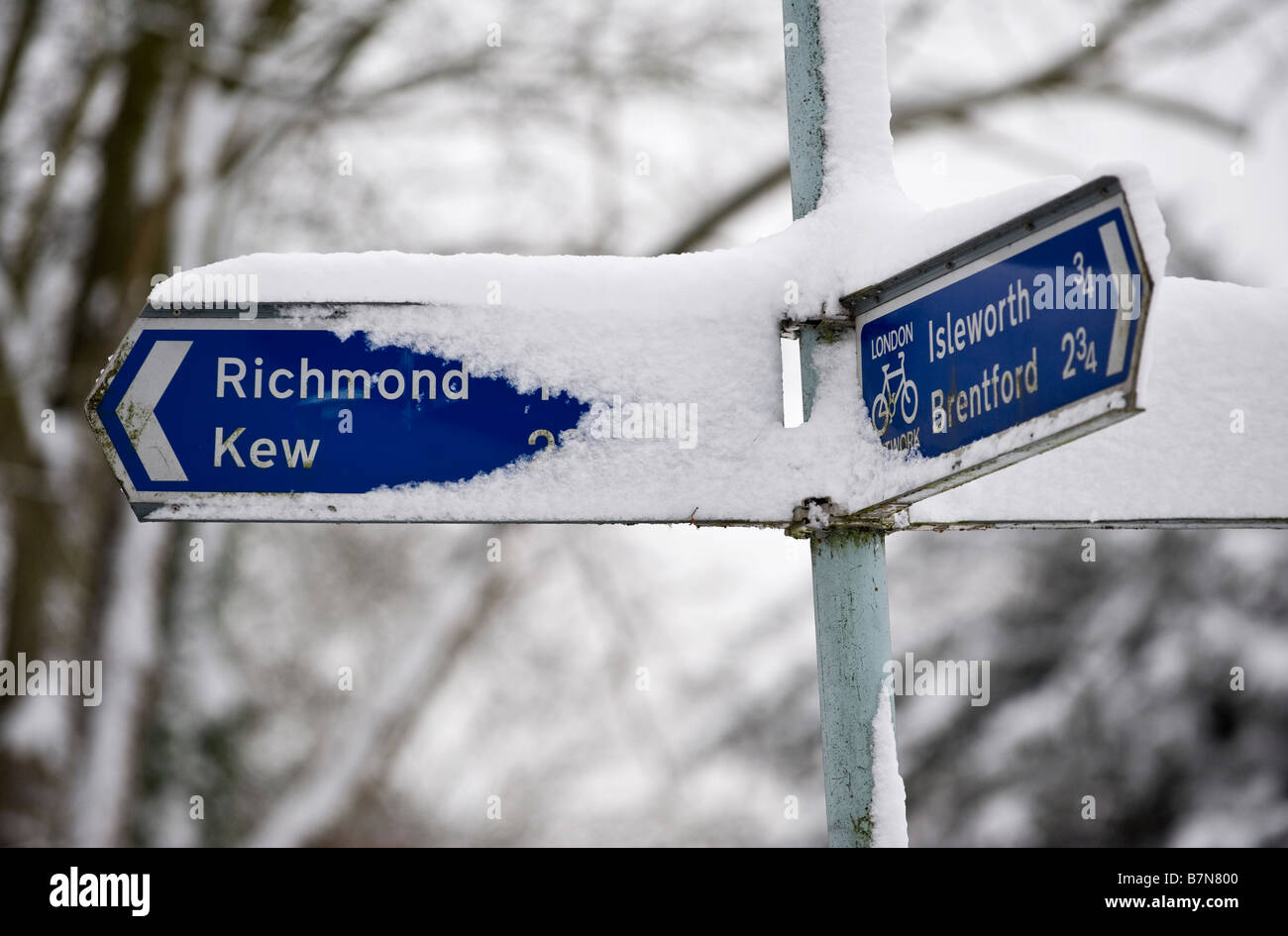 Richmond Kiew direction sign partially covered in snow - Stock Image