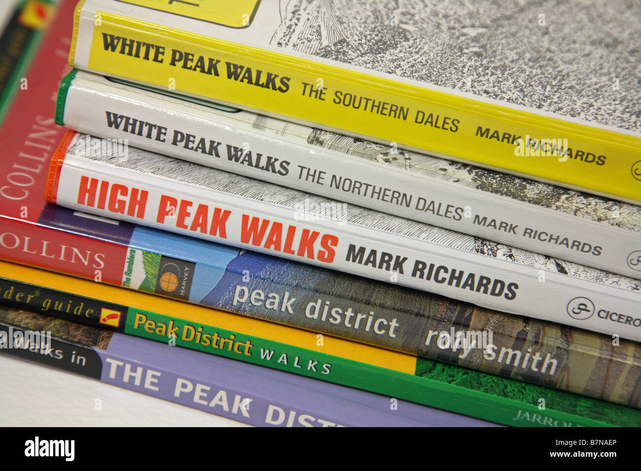 Peak District walking guide books in a pile or stack - Stock Image