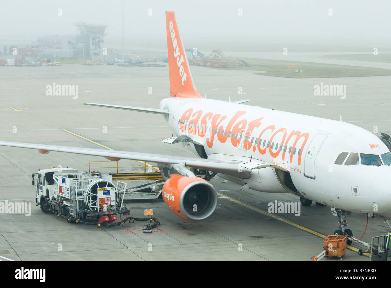 Easy Jet plane on stand Stansted Airport Essex England - Stock Image