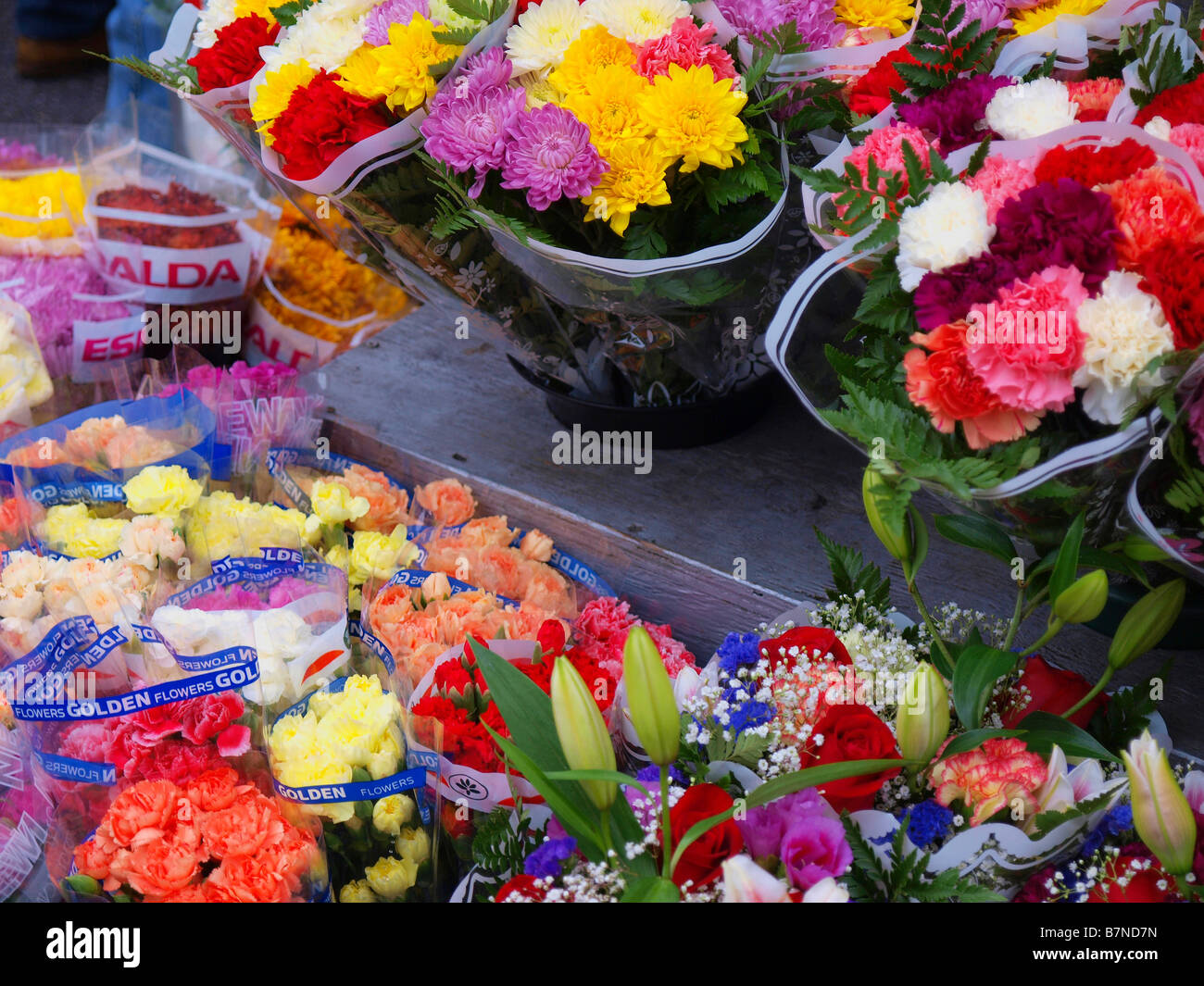 Flowers On Display From A Street Vendor In New York City Stock Photo