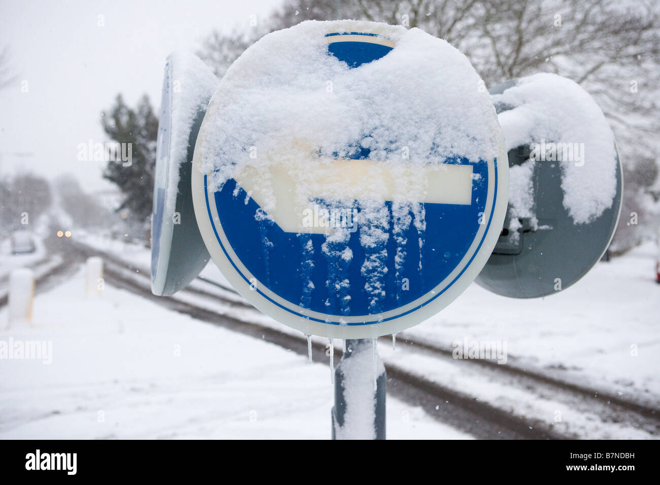 Snow and ice covers a traffic sign in Muswell Hill north London on the 2nd of February 2009 - Stock Image