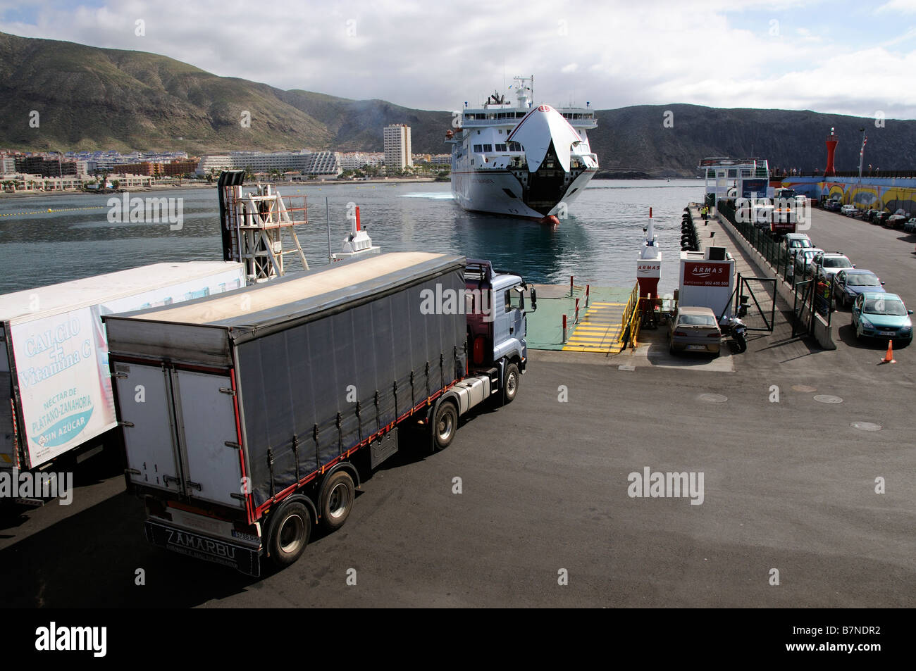 Freight lorry waits to embark onto inter island roro ferry Los Cristianos port Tenerife Canary Islands - Stock Image