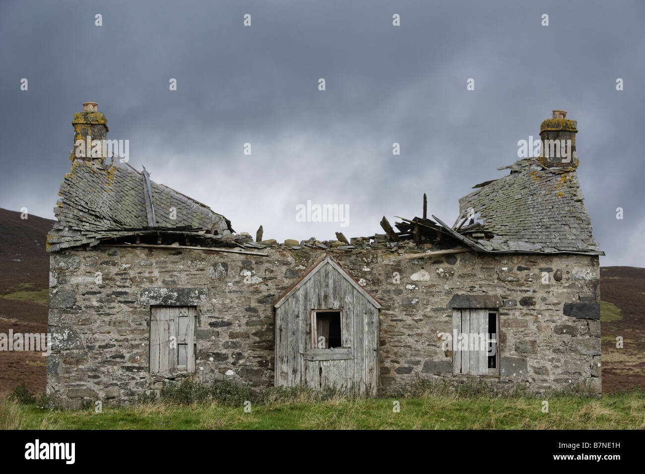 Delapidated house against grey sky Perthshire Scotland - Stock Image