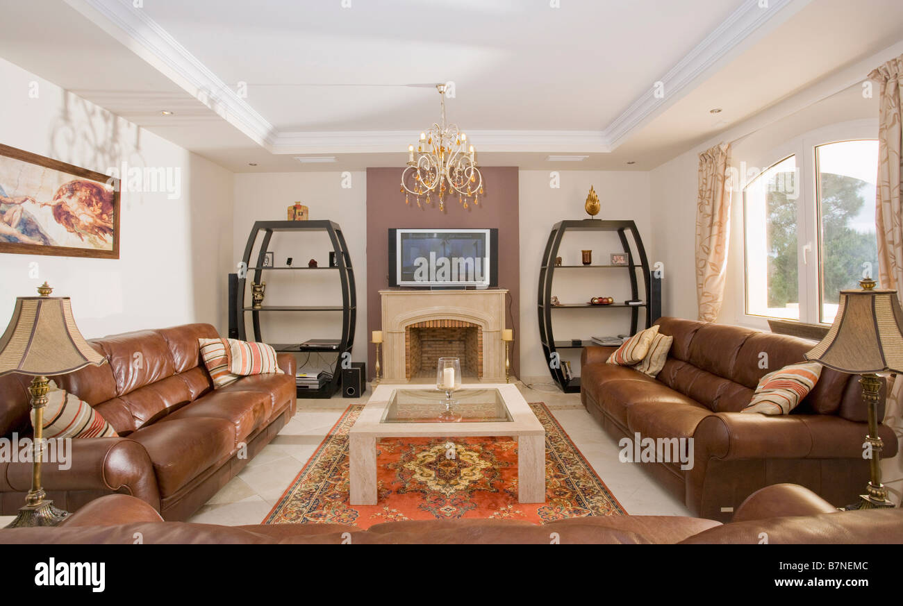 Television Above Fireplace In Modern Spanish Living Room