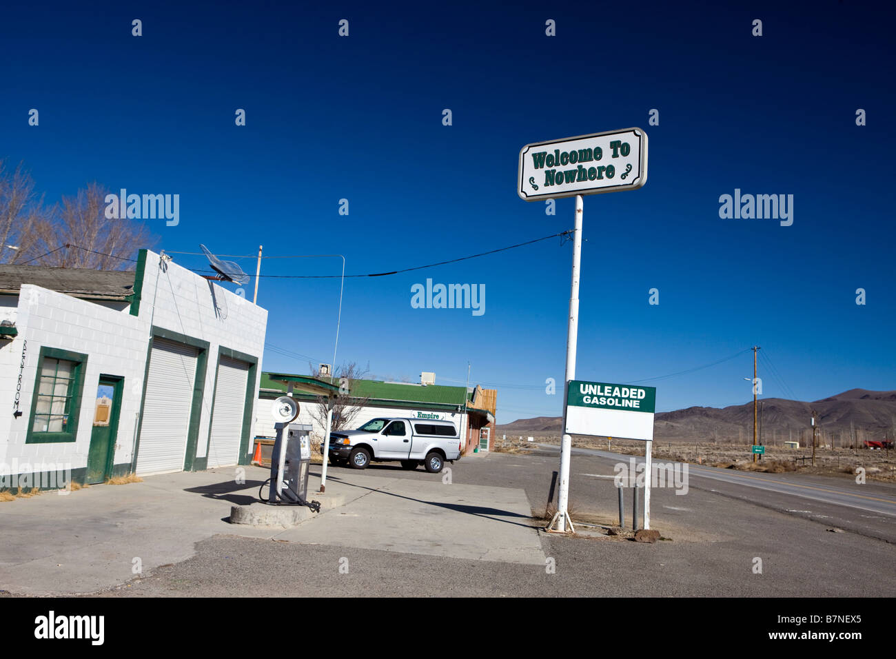 Sign at closed gas station reads Welcome to Nowhere off NV route 447 near Empire Nevada Stock Photo
