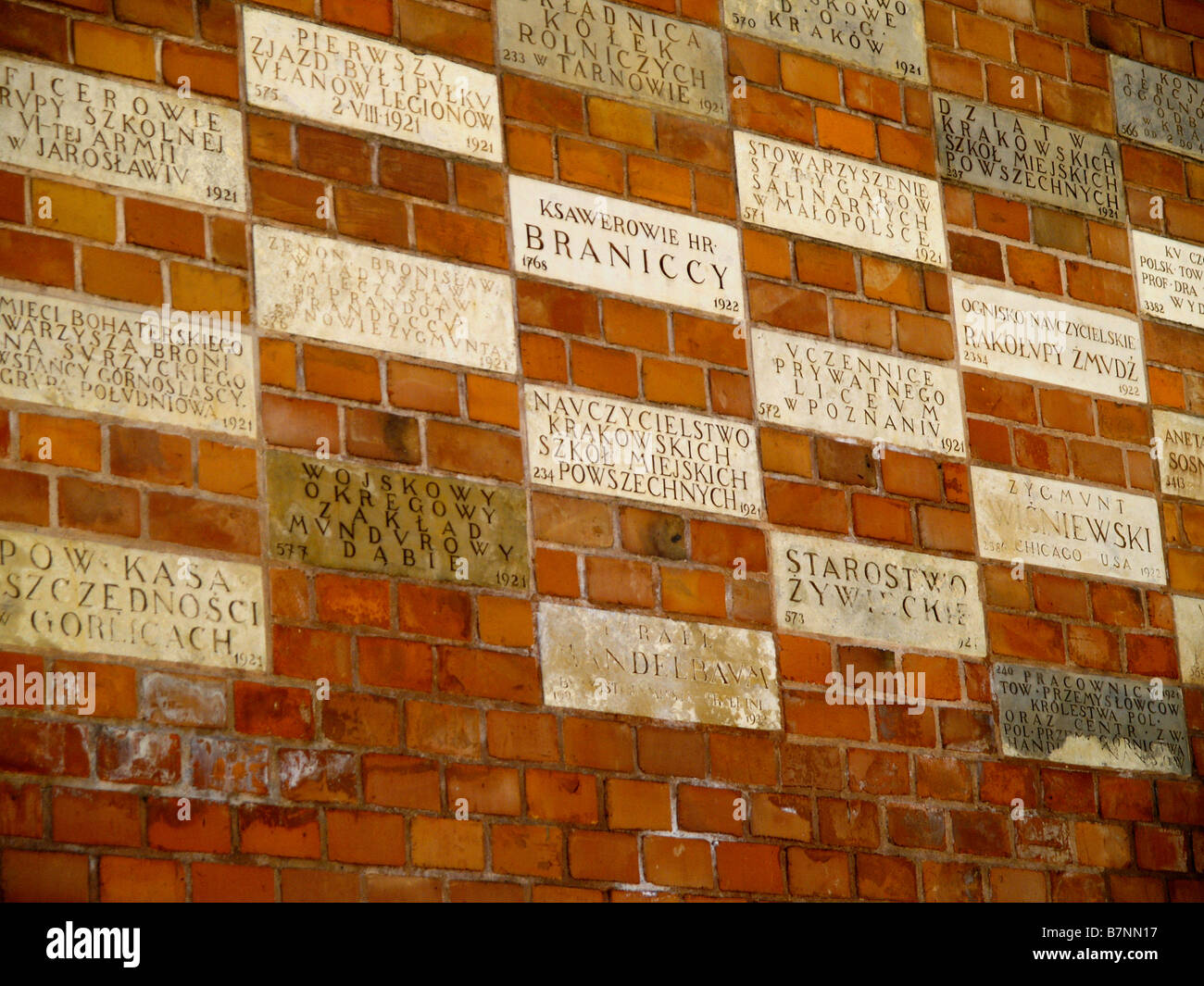 Blocks etched with names of sponsors of Wawel castle reconstruction and renovation efforts in Krakow, Poland. - Stock Image