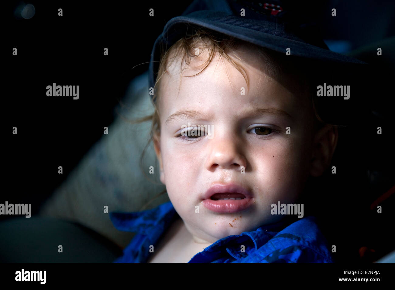 Portrait of tired boy - Stock Image