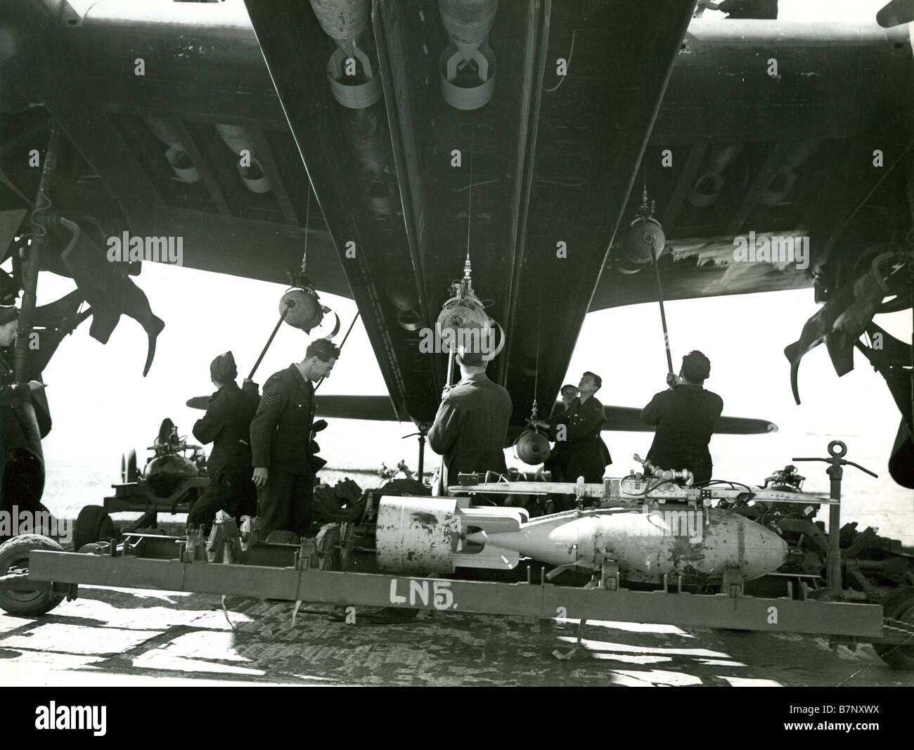 SHORT STIRLING  An RAF armament crew load 500lb bombs into the huge bay  at an unidentified Squadron base during - Stock Image