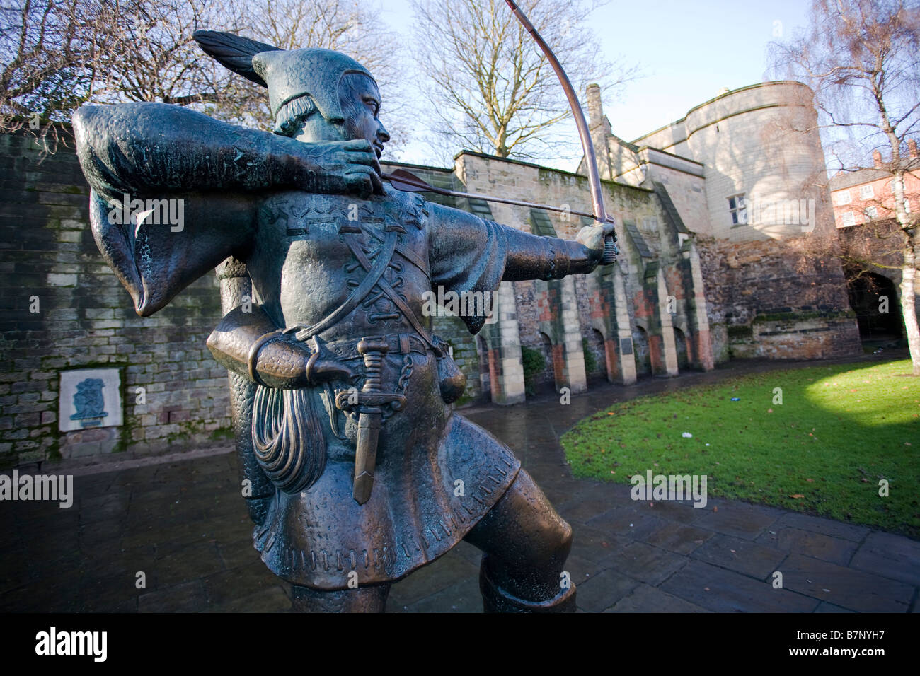 A bronze statue of Robin Hood outside Nottingham Castle, England. - Stock Image