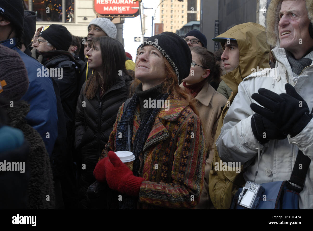 Thousands of people gather in Times Square in New York on Tuesday January 20 2009 to watch the inauguration of Barack - Stock Image