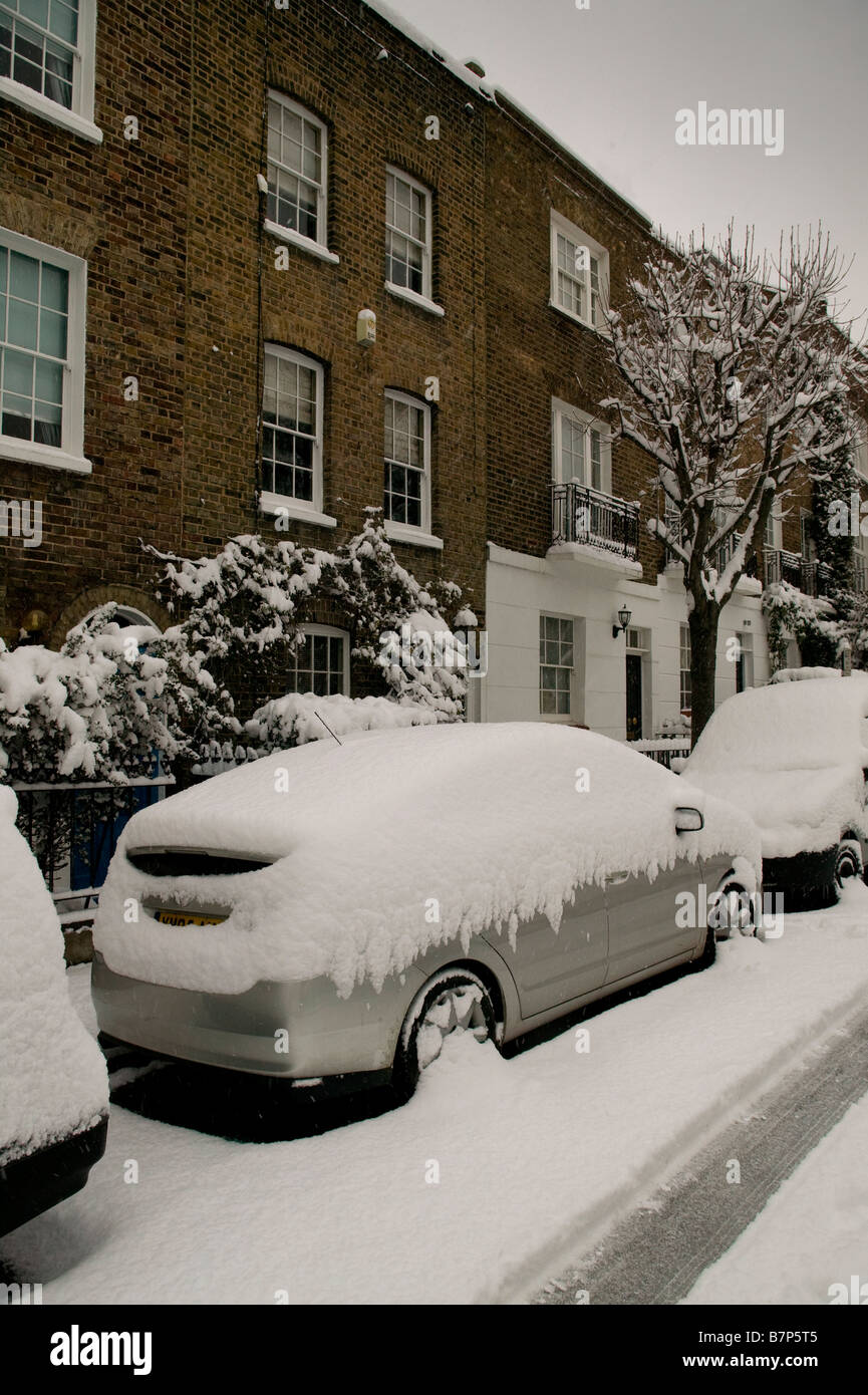 London Street covered with fresh snow - Stock Image