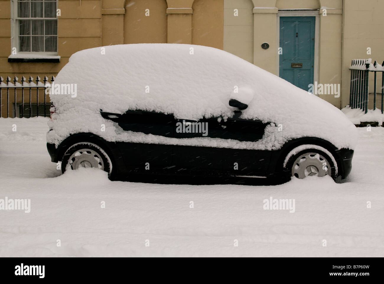 Snow covered car in London - Stock Image