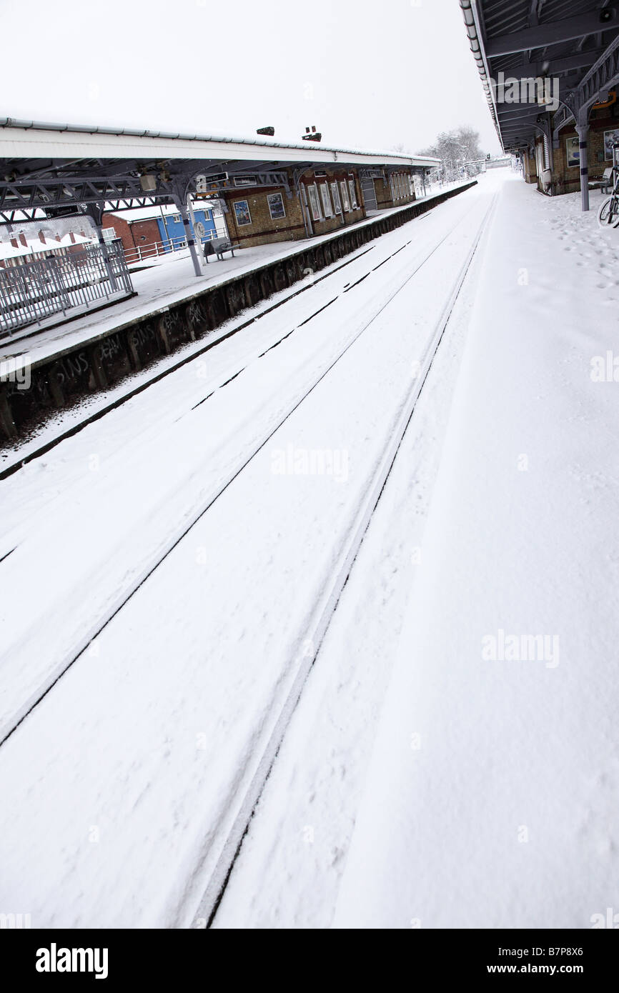 A suburban railway station deserted due to heavy snow fall and frozen points - Stock Image