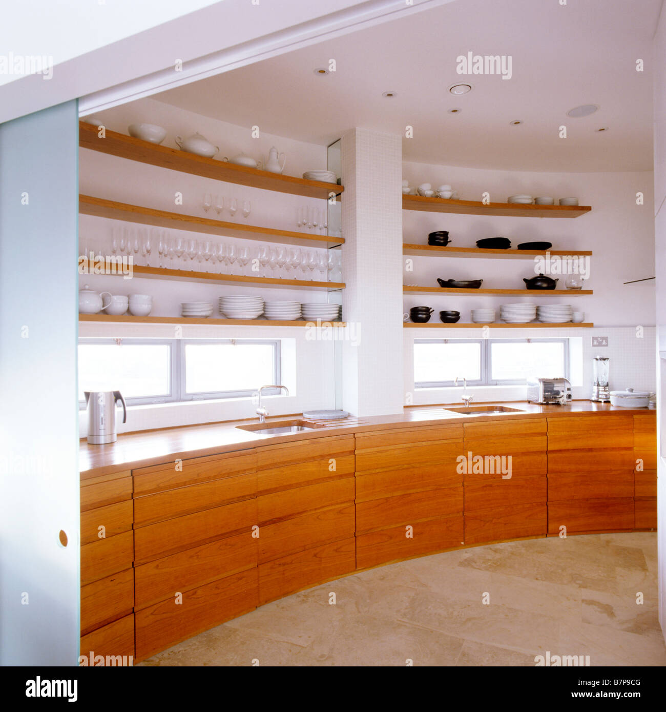Modern kitchen with wood storage units and surfaces in London Penthouse designed by Piers Gough & Modern kitchen with wood storage units and surfaces in London Stock ...