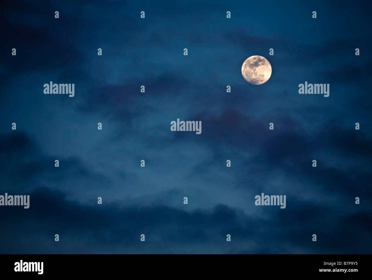 Moon seen through clouds - Stock Image