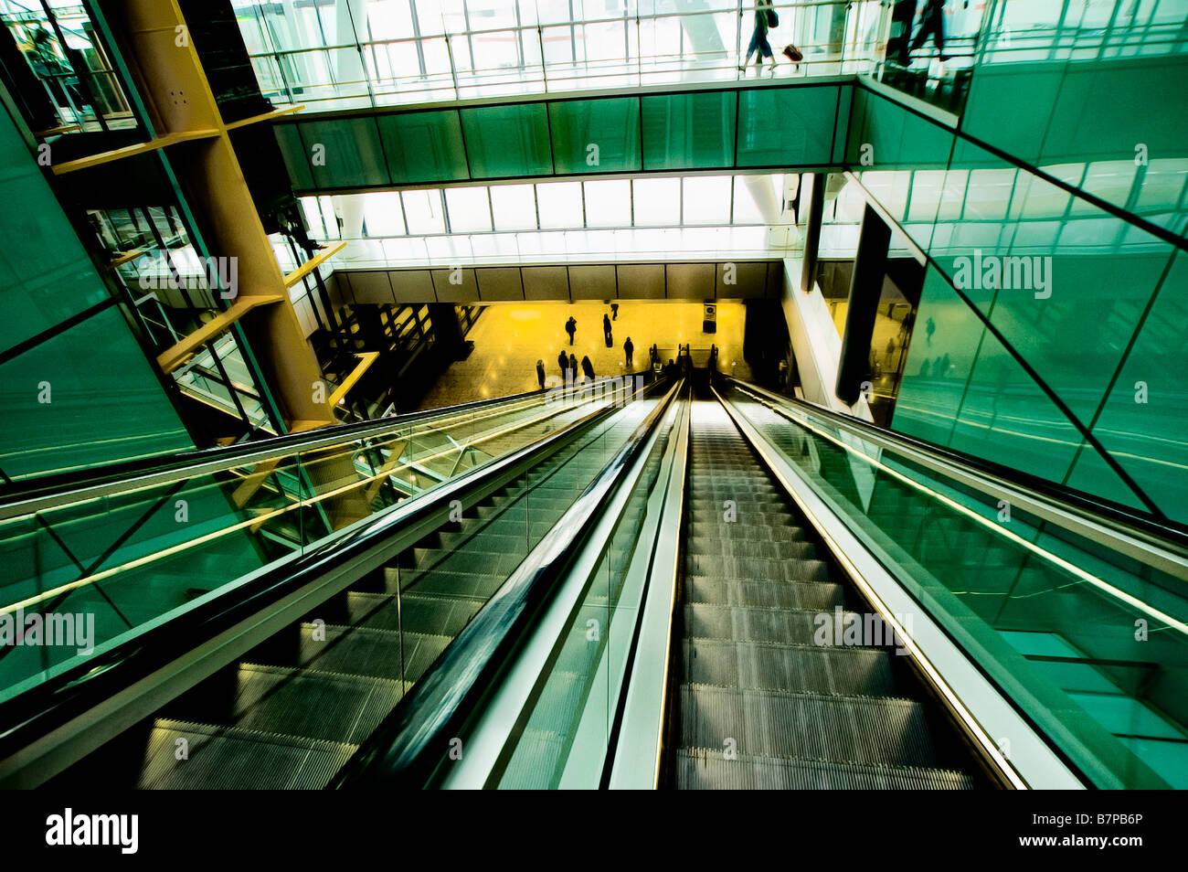 Escalators in the new Terminal 5 at Heathrow. - Stock Image