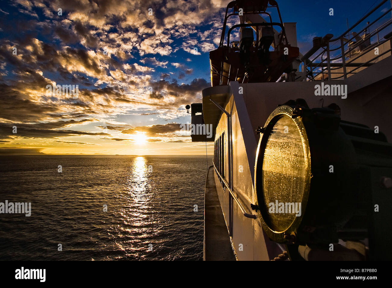 Sunset reflected on the M/V Columbia ship, in the Inside Passage. - Stock Image