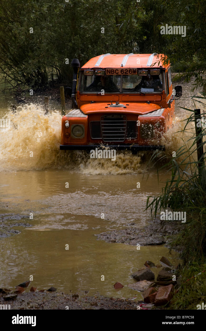 Landrover Series 3 fording river - Stock Image