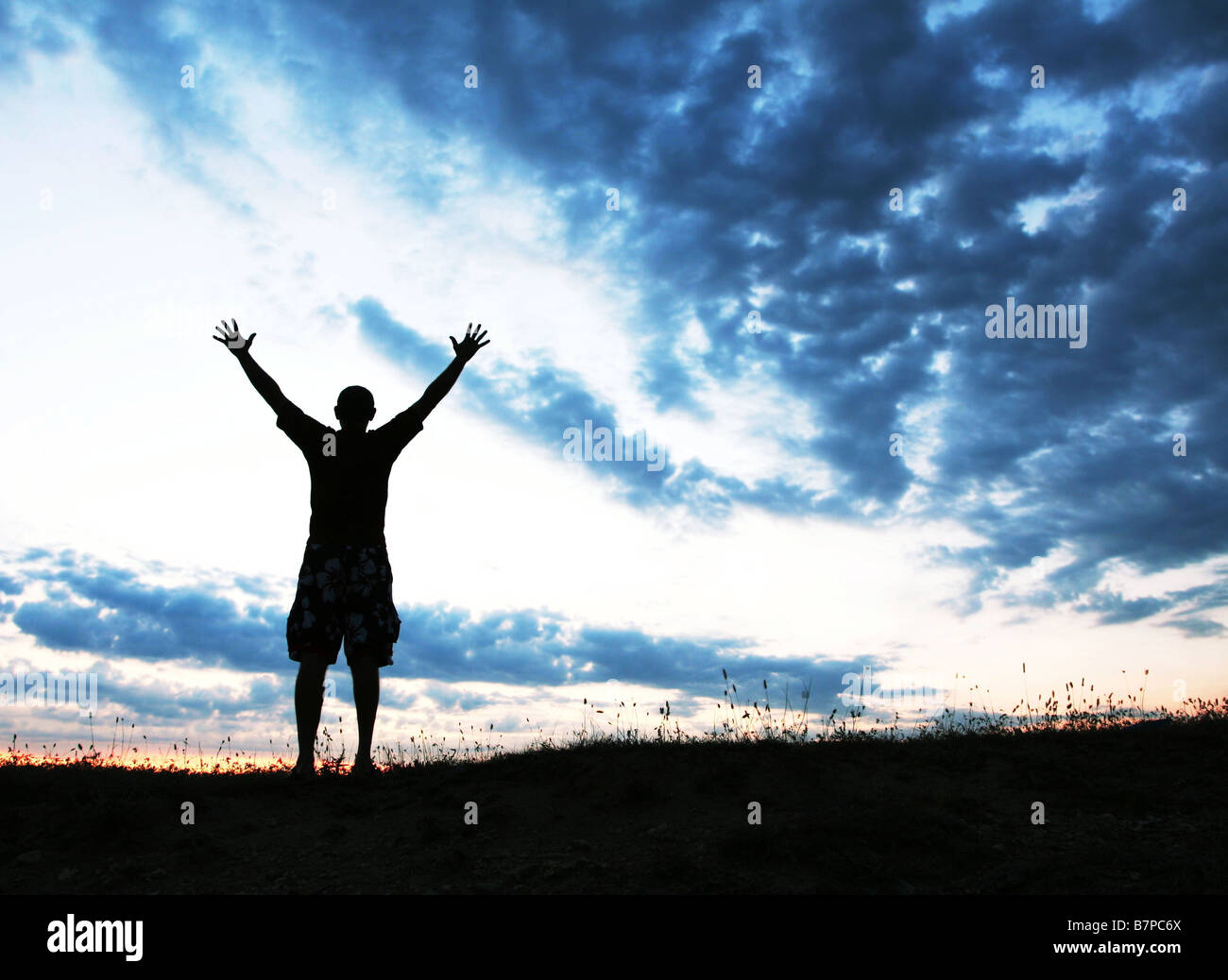 Happy man silhouette - Stock Image