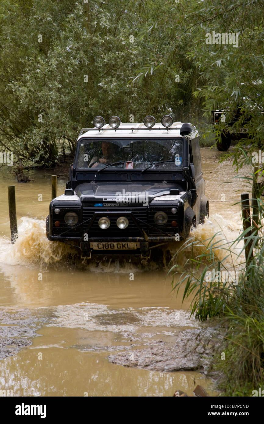 Landrover Defender fording river - Stock Image
