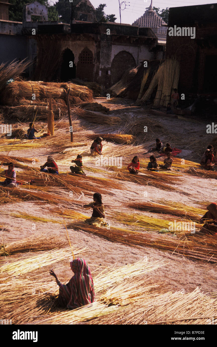Child workers in village in Agra India - Stock Image