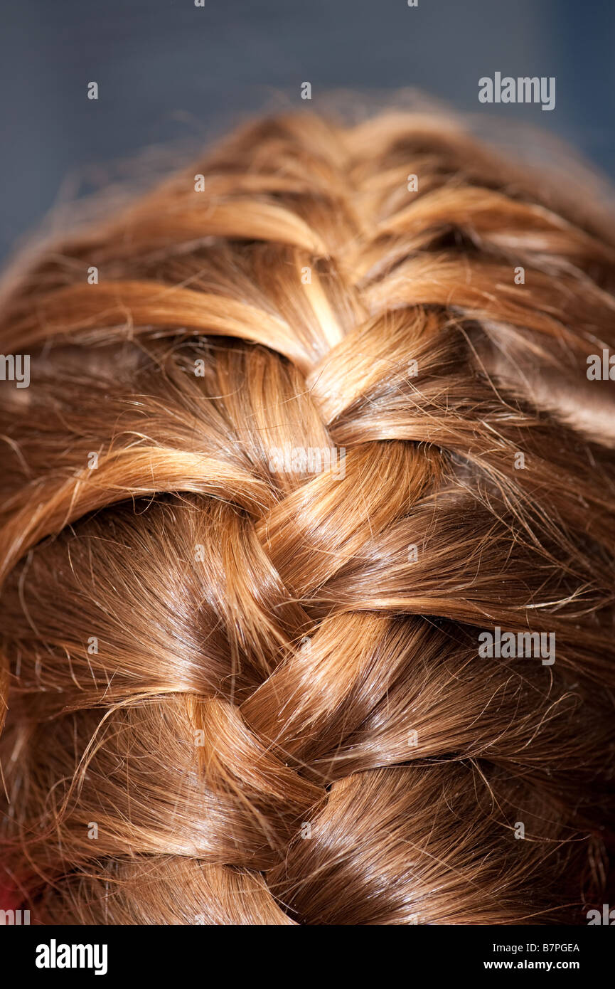 French plaits in a young girl s hair - Stock Image