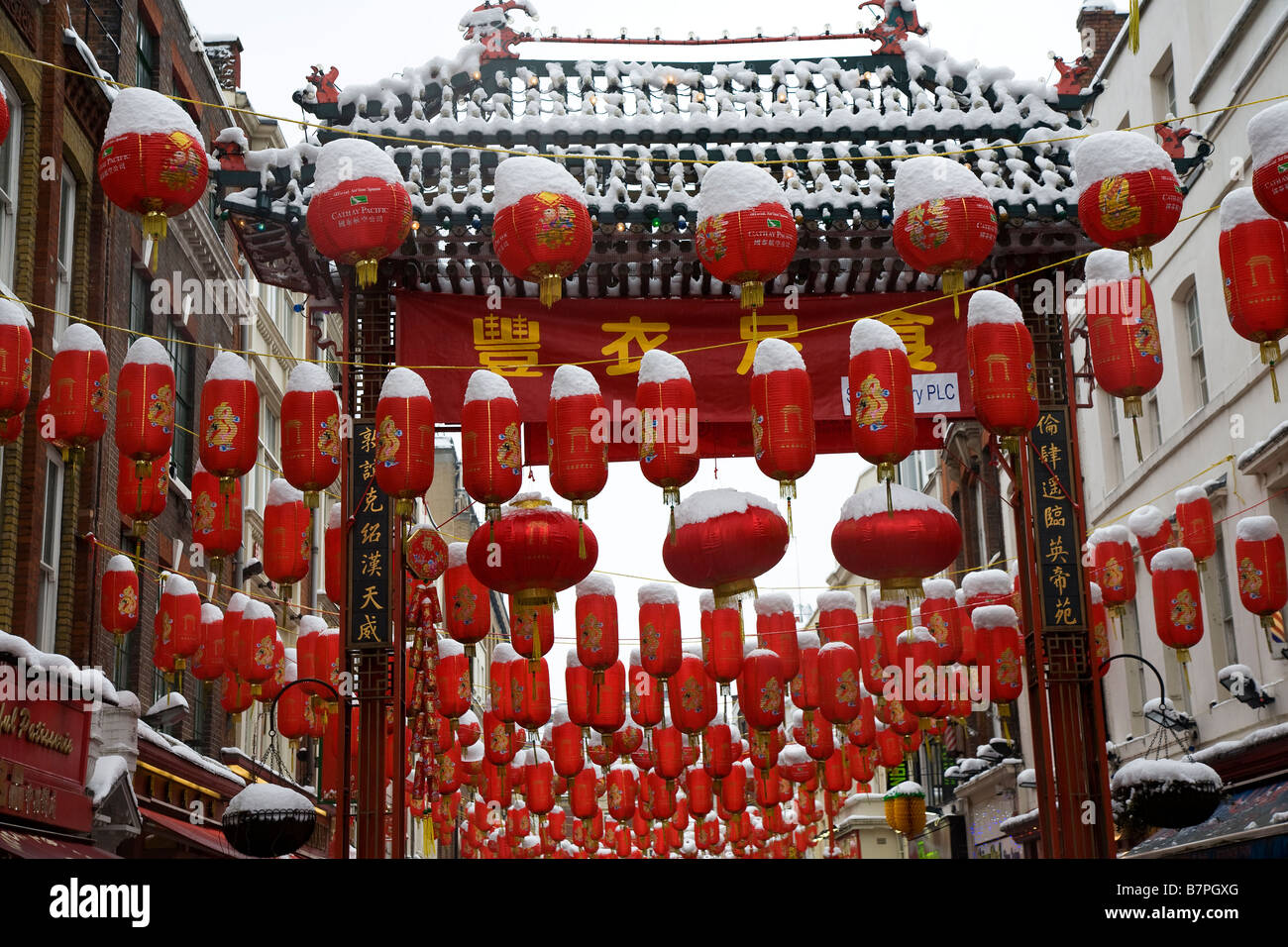 Chinese lanterns in the snow - Stock Image