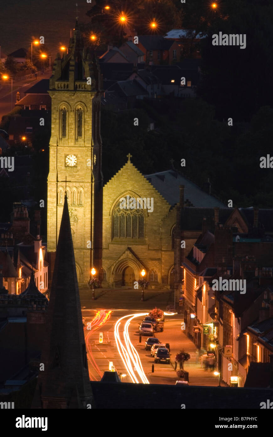Night time view towards Peebles High Street and the old Parish Church Scottish Borders Scotland August - Stock Image
