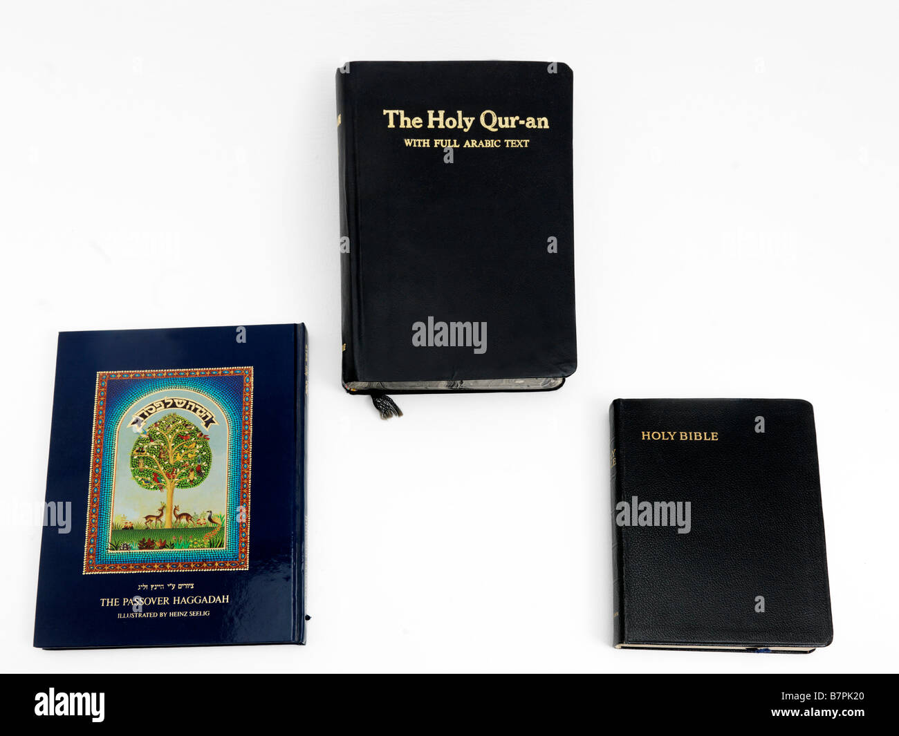 Holy Books Bible Quran and Haggadah - Stock Image