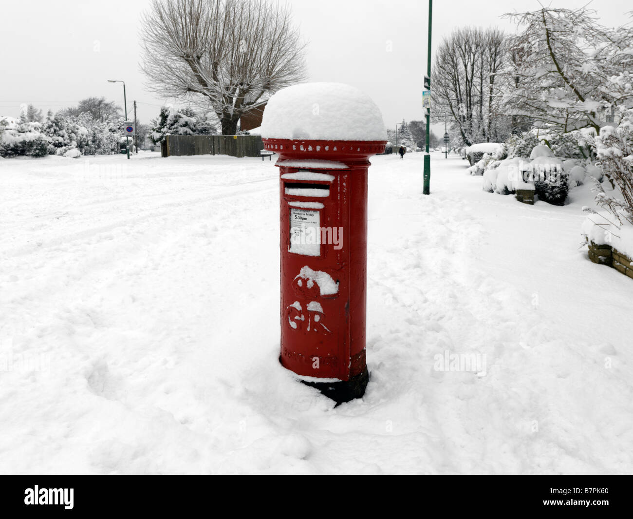 Postbox after heavy Snowfall Surrey England - Stock Image