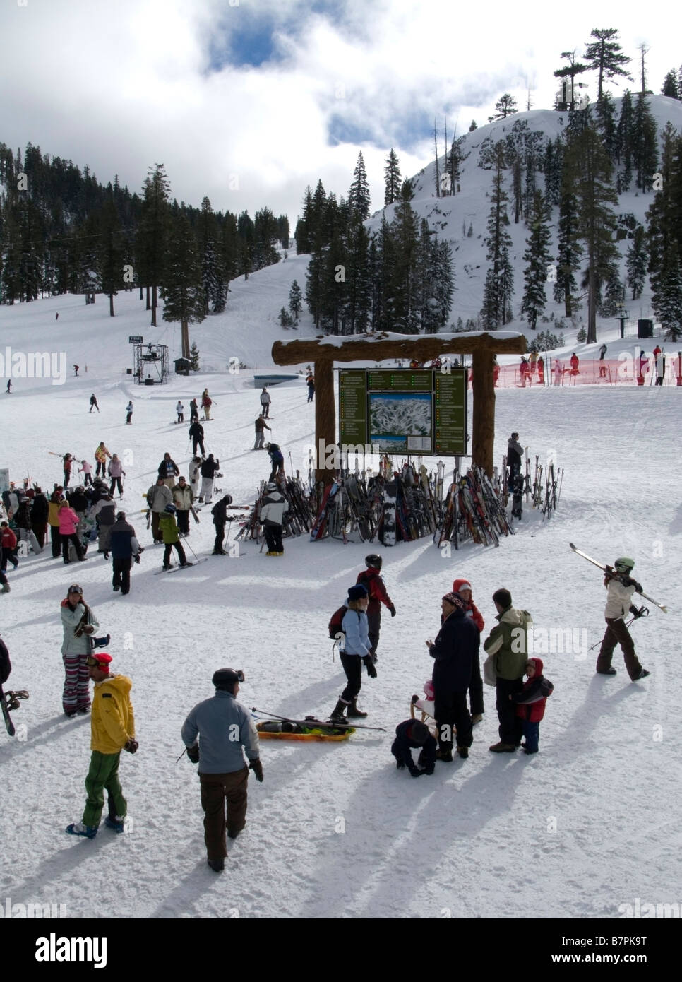 Skiers in the morning outside of the main lodge at the base area of Alpine Meadows ski area 6,835 feet above Lake Stock Photo