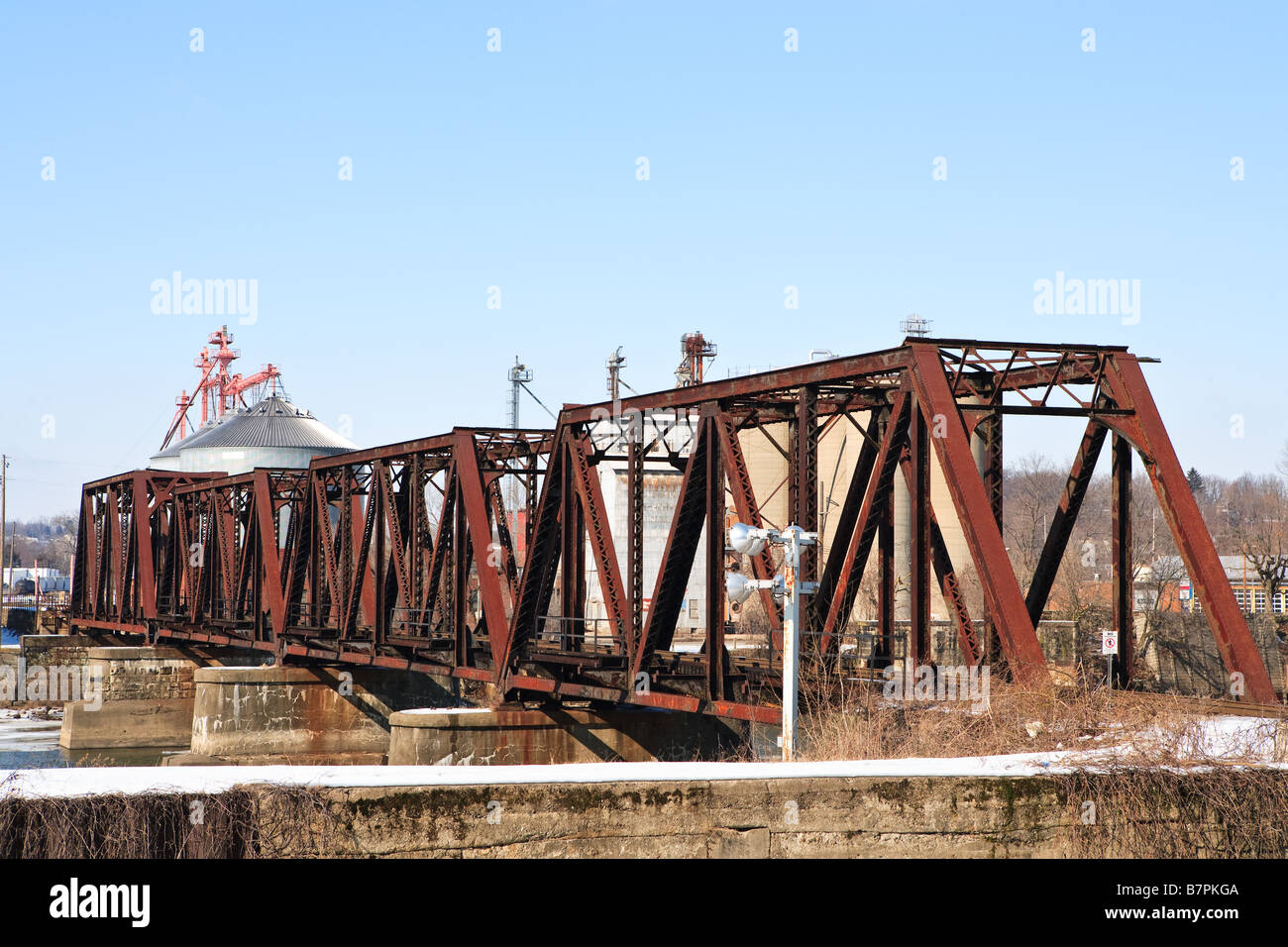 A railroad bridge spans a river Stock Photo