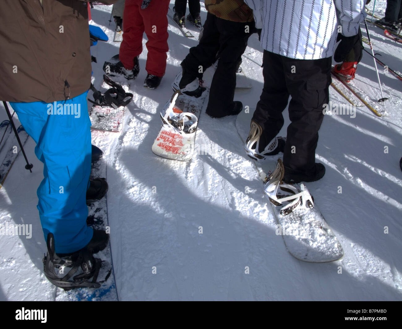Snowboarders waiting in the chairlift line at Alpine Meadows Ski Area above North Lake Tahoe, CA. Stock Photo