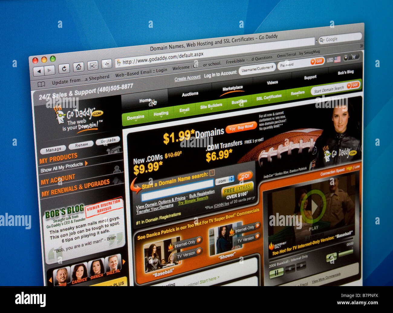 Godaddy website homepage displayed on computer screen. - Stock Image