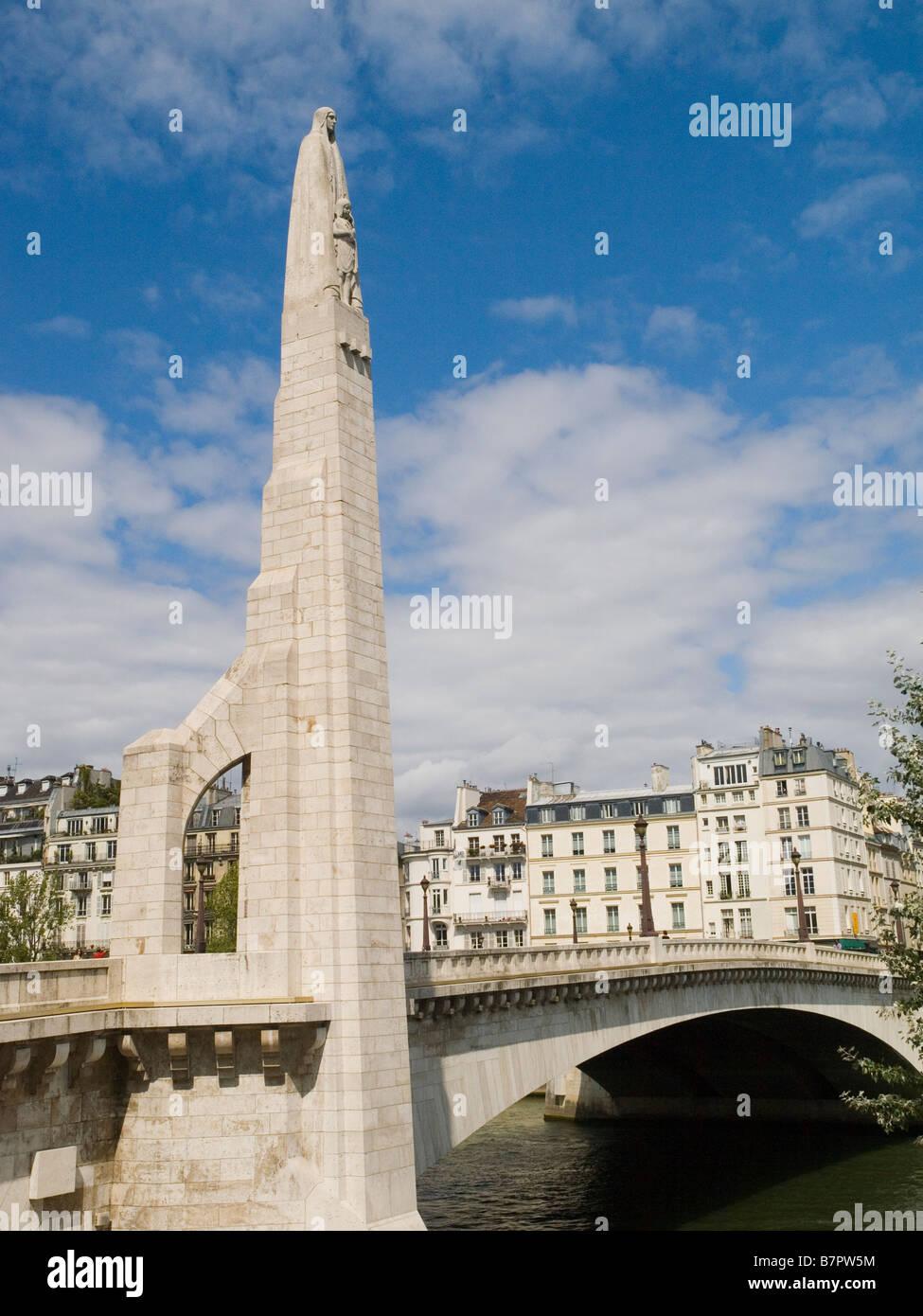 Tall statue of Saint Genevieve on Pont de la Tournelle Paris France Europe - Stock Image