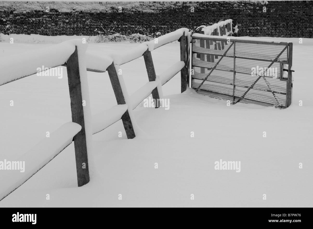Farm fence covered in snow England UK - Stock Image
