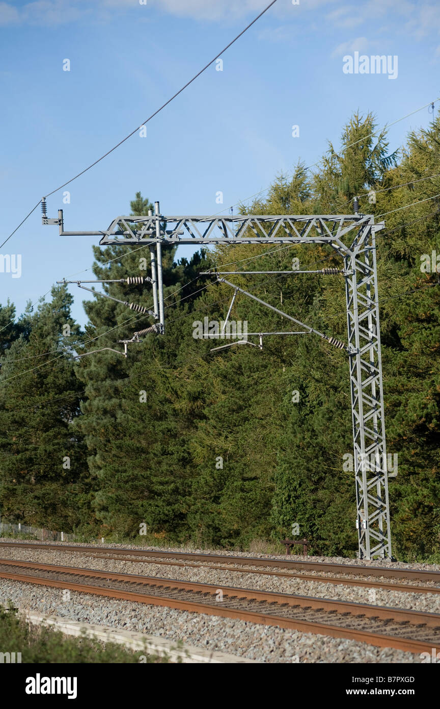 Steel gantry track and railway catenary on the west coast main line in England - Stock Image