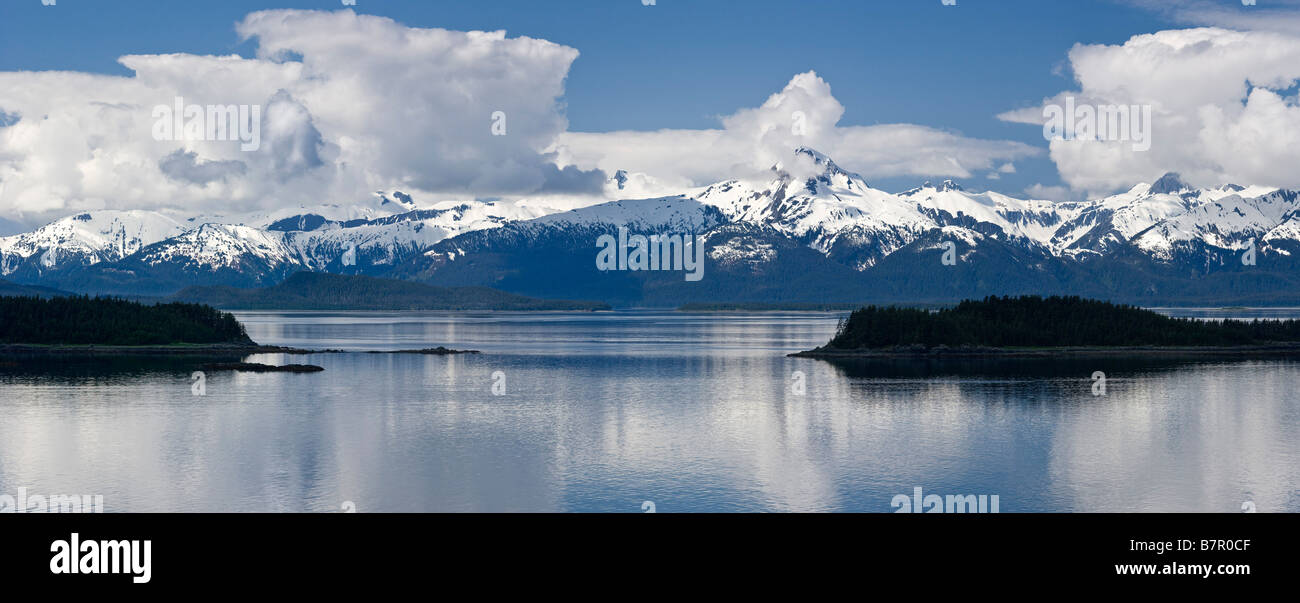 Clouds parting on a summer morning over Lynn Canal and the Chilkat Mountains in Southeast Alaska's Inside Passage - Stock Image