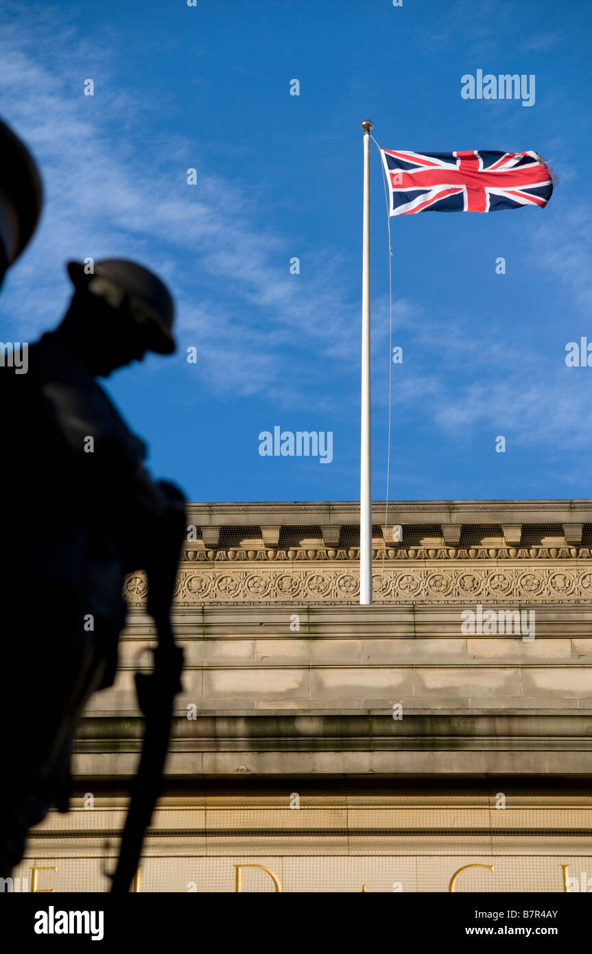 War memorial with Union Jack in background - Stock Image