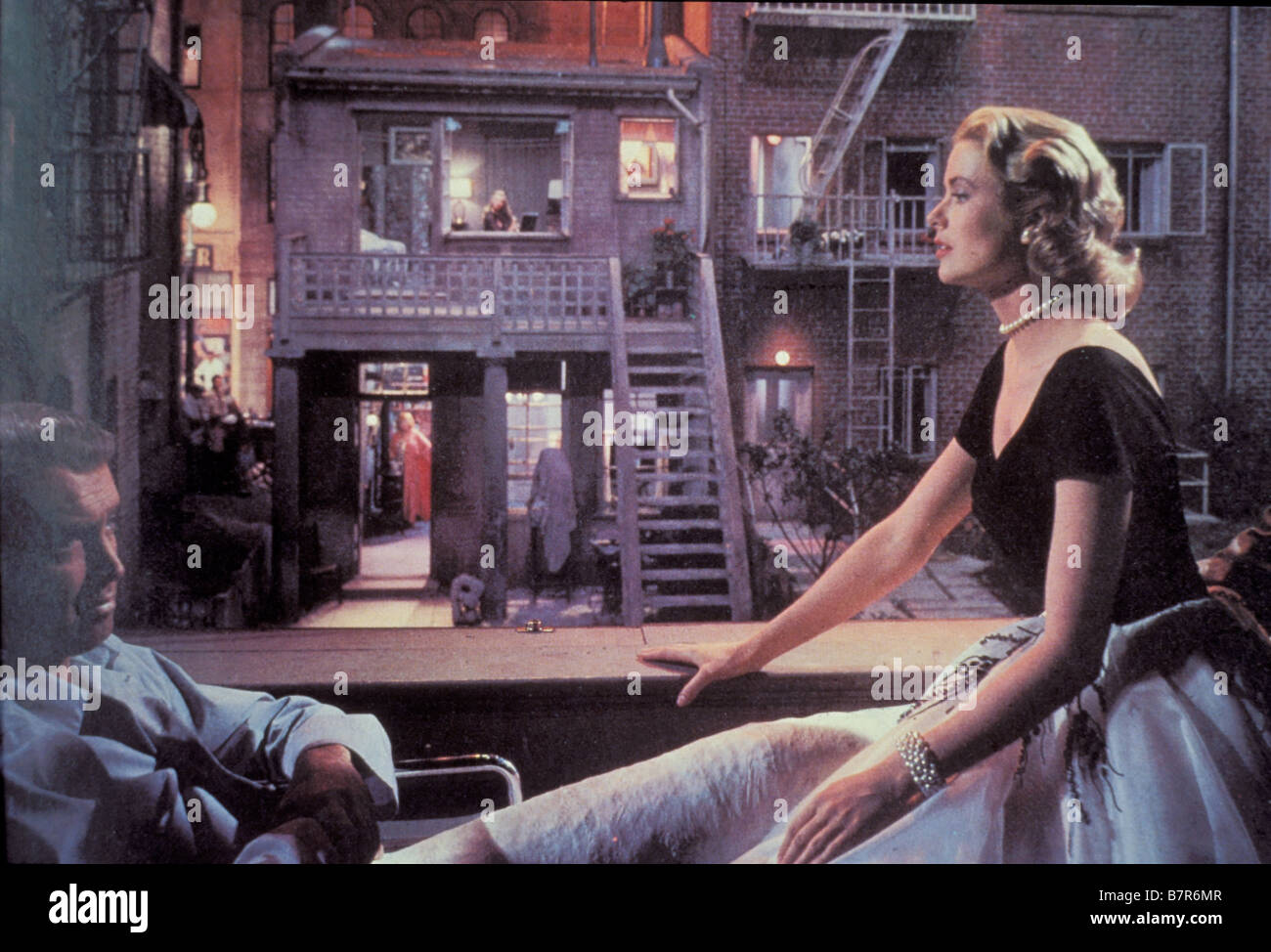 Rear Window Year: 1954 USA Director: Alfred Hitchcock James Stewart, Grace Kelly - Stock Image