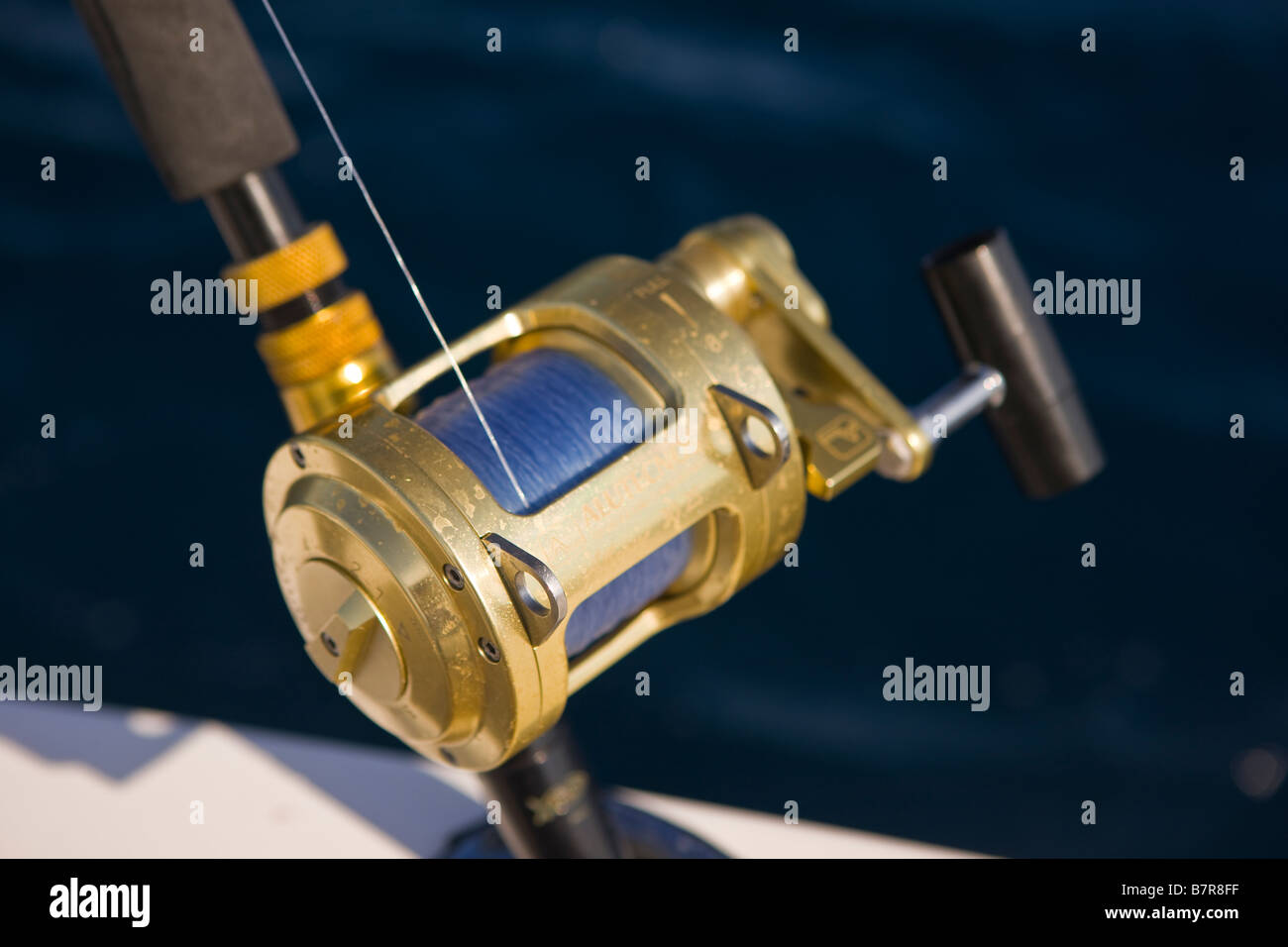 MIAMI BEACH FLORIDA USA - Brass fishing reel - Stock Image